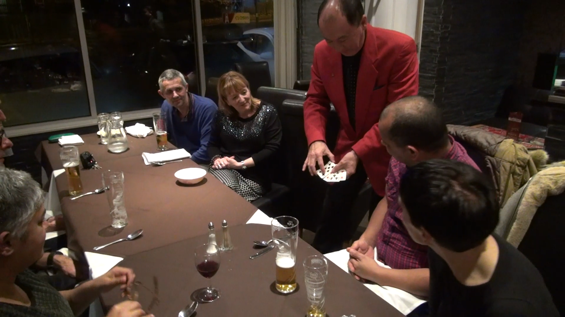 Table in restaurant with card trick